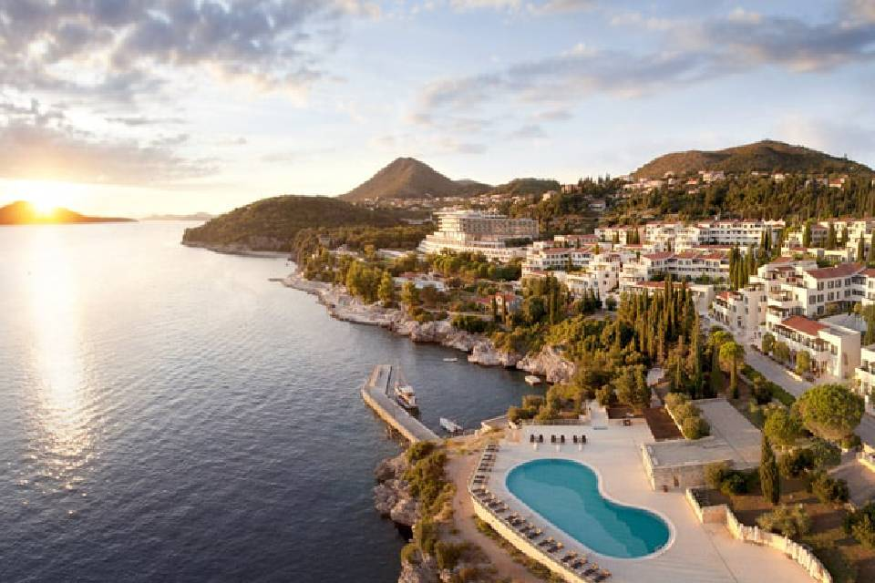 A aerial view of a beautiful location with sea and resort with spa.